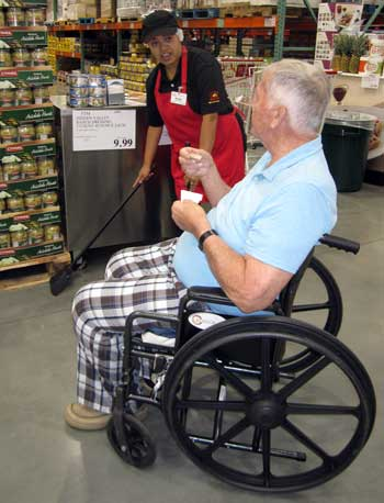 Dad is enjoying a free food sample at Costco