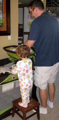 Chloe pulls her stool over to help Dad with Noah