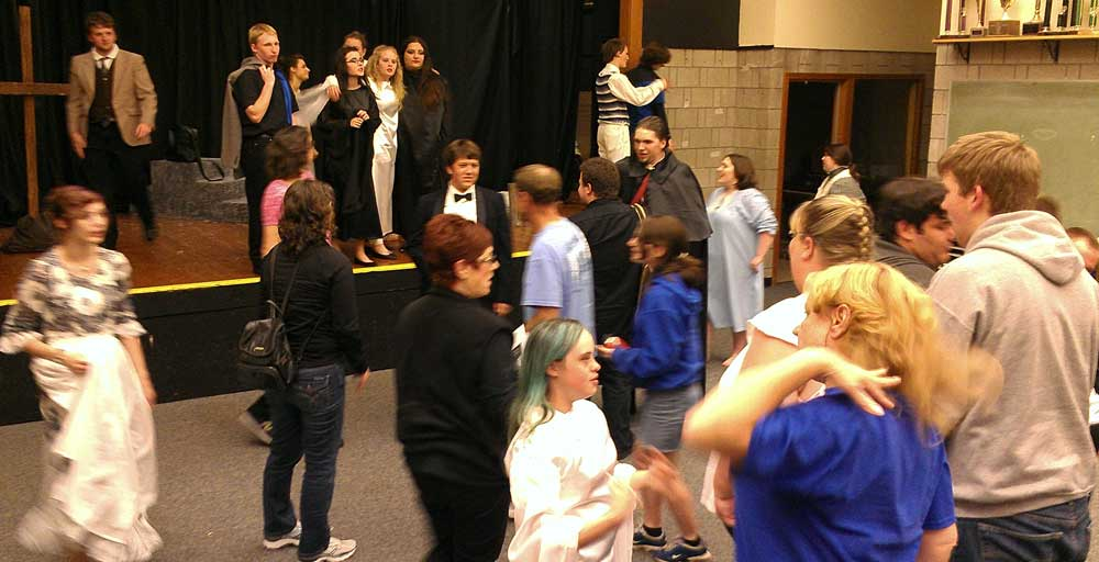 Sutherlin High School actors congratulate each other at the end of Dracula