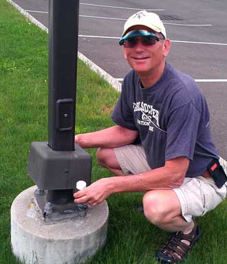 Dale finds a cache under the pedastal of a light post