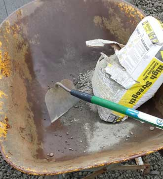 mixing cement for the first time in a long time, Behind: the beginning of the clothesline pad