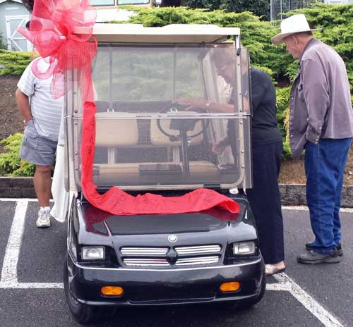 The new (used) golf cart for the Welcome committee