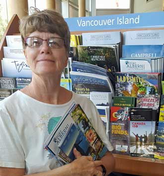 Gwen is pickup up free brochures at the BC visitor center