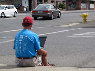 Sitting on a curb in Yuba City, California uploading a video to YouTube