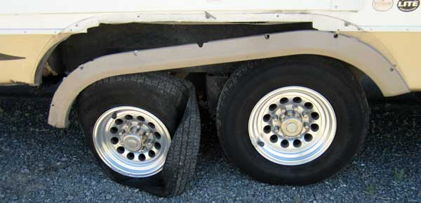 Rear right side trailer tire blows